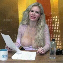 Big Tit Blonde can't speak normally on the News