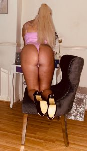 Pretty in pink with a peachy butt